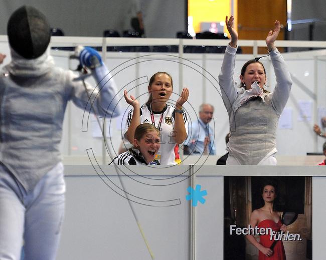 European Championships Fencing 2010 / Fecht Europameisterschaft 2010 in Leipzig - Competition Championat d'europe - im Bild: womens foil team - the German national team - the other team members celebrate the last hit of Katja Wächter (in front) in semi finale  . Foto: Norman Rembarz..Norman Rembarz , Autorennummer 41043728 , Augustenstr. 2, 04317 Leipzig, Tel.: 01794887569, Hypovereinsbank: BLZ: 86020086, KN: 357889472, St.Nr.: 231/261/06432 - Jegliche kommerzielle Nutzung ist honorar- und mehrwertsteuerpflichtig! Persönlichkeitsrechte sind zu wahren. Es wird keine Haftung übernommen bei Verletzung von Rechten Dritter. Autoren-Nennung gem. §13 UrhGes. wird verlangt. Weitergabe an Dritte nur nach  vorheriger Absprache..