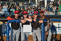 Salem-Keizer Volcanoes teammates Joey Bart (46), Seth Corry (28), Nico Giarratano (6), and Christopher Burks (26) pose for a photo before a Northwest League game against the Hillsboro Hops at Ron Tonkin Field on September 1, 2018 in Hillsboro, Oregon. The Salem-Keizer Volcanoes defeated the Hillsboro Hops by a score of 3-1. (Zachary Lucy/Four Seam Images)