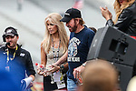 Gena and Chuck Norris in action before the NASCAR AAA Texas 500 race at Texas Motor Speedway in Fort Worth,Texas.