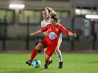 Tess Lameir (14) of OHL and Taika De Koker (20) of Woluwe in action during a female soccer game between FC Femina White Star Woluwe and Oud Heverlee Leuven on the fourth matchday in the 2021 - 2022 season of Belgian Scooore Womens Super League , Friday 10 th of September 2021  in Woluwe , Belgium . PHOTO SPORTPIX   SEVIL OKTEM
