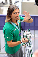 Pedro Mendes (6) of Sporting Clube de Portugal waves to the fans after receiving the trophy. Tottenham Hotspur F. C. and Sporting Clube de Portugal played to a 2-2 tie during a Barclays New York Challenge match at Red Bull Arena in Harrison, NJ, on July 25, 2010.
