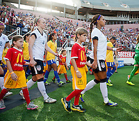 Player escorts, Sydney Leroux, Becky Sauerbrunn.  The USWNT defeated Brazil, 4-1, at an international friendly at the Florida Citrus Bowl in Orlando, FL.