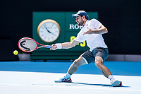 16th February 2021, Melbourne, Victoria, Australia; Aslan Karatsev of Russia returns the ball during the quarterfinals of the 2021 Australian Open on February 16 2021, at Melbourne Park in Melbourne, Australia.
