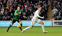 Tuesday 01 January 2013<br /> Pictured: Michu of Swansea (R) is denied yet again another opportunity to score a goal by Aston Villa goalkeeper Brad Guzan (L)<br /> Re: Barclays Premier League, Swansea City FC v Aston Villa at the Liberty Stadium, south Wales.