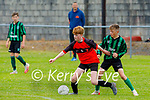 Tralee Dynamos Conor Lucey in possession as Fenit Samphires Kealan Down attempts to tackle him in their u14 cup encounter