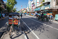 Yogyakarta, Java, Indonesia.  Malioboro Street, Early Morning, Becak (Man-powered tricycle rickshaw) and Horse-drawn Carriage.