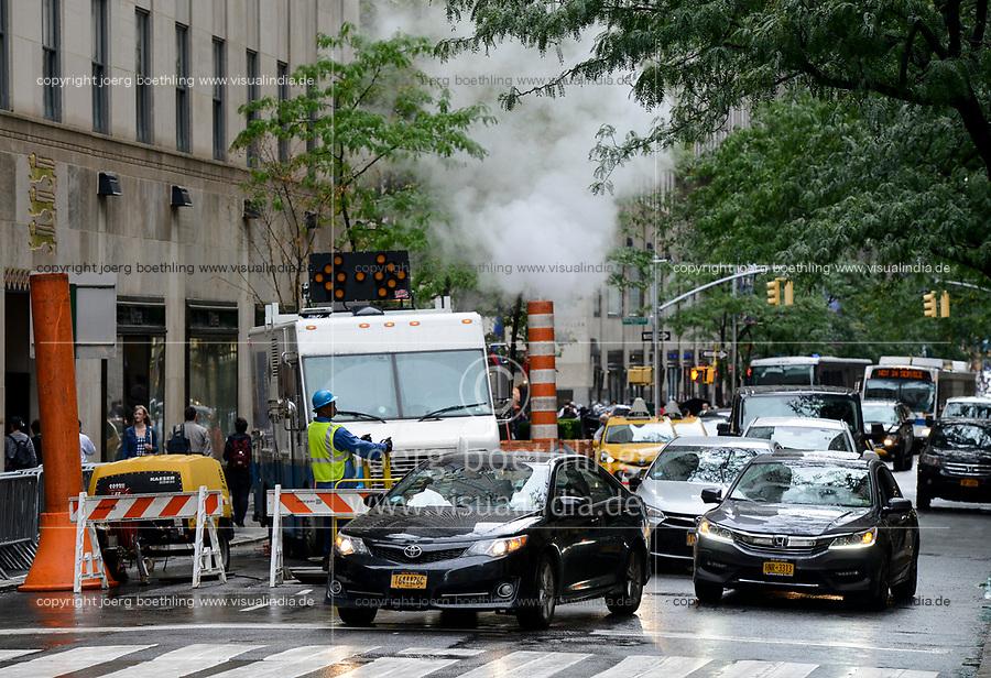USA, New York City, Manhattan, busy street with steam pipe