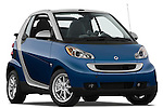 Low aggressive passenger side front three quarter view of a 2009 SmartForTwo Cabriolet.