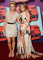 NASHVILLE, TN, USA - JUNE 04: Miranda Lambert, Carrie Underwood at the 2014 CMT Music Awards held at the Bridgestone Arena on June 4, 2014 in Nashville, Tennessee, United States. (Photo by Celebrity Monitor)