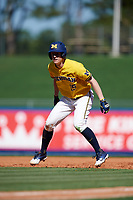 Michigan Wolverines third baseman Jimmy Kerr (15) leads off first base during a game against Army West Point on February 17, 2018 at Tradition Field in St. Lucie, Florida.  Army defeated Michigan 4-3.  (Mike Janes/Four Seam Images)