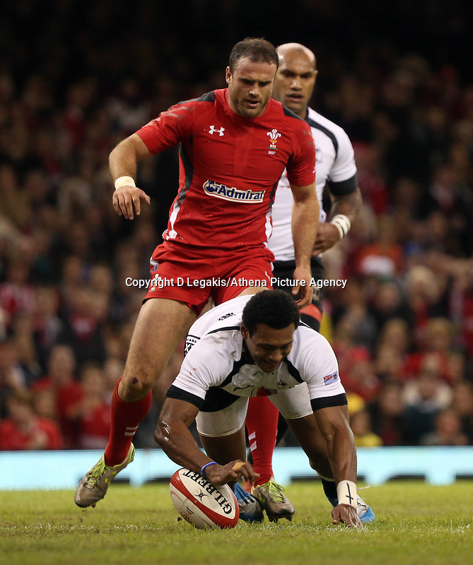 Pictured: Waisea Nayacalevu of Fiji (FRONT) scoring a try which was eventually disallowed, closely followed by Jamie Roberts of Wales. Saturday 15 November 2014<br />