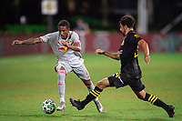 LAKE BUENA VISTA, FL - JULY 16: Kyle Duncan #6 of the New York Red Bulls dribbles the ball during a game between New York Red Bulls and Columbus Crew at Wide World of Sports on July 16, 2020 in Lake Buena Vista, Florida.