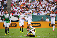 Cristiano Ronaldo (7) of Real Madrid jumps over the tackle of Joe Ledley (16) of Celtic F. C. during a 2012 Herbalife World Football Challenge match at Lincoln Financial Field in Philadelphia, PA, on August 11, 2012.