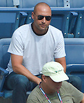 Derek Jeter watches as Jamie Loeb (USA) loses to Caroline Wozniacki (DEN)  6-2, 6-0 at the US Open in Flushing, NY on September 1, 2015.