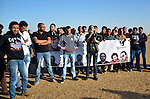 Members of the April 6 movement hold placards and shout slogans as they protest against the detention of several members of their movement, near Cairo city, April 6, 2015. According to local media, the protest was held to mark the eighth anniversary of the movement by calling for the release of the detainees. Photo by Amr Sayed