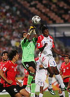 Egypt's Aly Lotfi (1)  makes a goal save against Costa Rica's Roy Smith (3) during the FIFA Under 20 World Cup Round of 16 match between Egypt and Costa Rica at the Cairo International Stadium on October 06, 2009 in Cairo, Egypt.