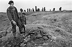 Callanish Standing Stones, Callanish Isle of Lewis and Harris,    Father and son pointing out an out lying burial 'cist'. Scotland 1970s UK.
