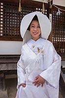 Japan, Okayama Prefecture, Kurashiki. Bride at her wedding at Tsuru gata yama park.