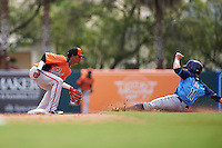 Baltimore Orioles Ricardo Andujar (10) tags Zacrey Law (11) sliding into second during an instructional league game against the Tampa Bay Rays on September 25, 2015 at Ed Smith Stadium in Sarasota, Florida.  (Mike Janes/Four Seam Images)