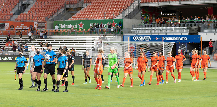 HOUSTON, TX - SEPTEMBER 10: The Houston Dash and the Chicago Red Stars enter the pitch before a game between Chicago Red Stars and Houston Dash at BBVA Stadium on September 10, 2021 in Houston, Texas.