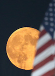 The waning super moon rises through smoky skies above the Reno Aces stadium in Reno, Nev., on Monday, Sept. 8, 2014. <br /> Photo by Cathleen Allison