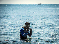 Aberystwyth, Ceredigion, Wales Monday 16th May 2016 UK Weather: People continue to take advantage of the warm weather. A young man prepares to go snorkeling.