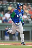 Shortstop Jeison Guzman (11) of the Lexington Legends runs out a batted ball during a game against the Greenville Drive on Saturday, September 1, 2018, at Fluor Field at the West End in Greenville, South Carolina. Greenville won, 9-6. (Tom Priddy/Four Seam Images)