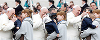 - COMBO PICTURE - <br /> Papa Francesco bacia un bambino e gli sistema il cappuccio sulla testa al termine dell'udienza generale del mercoledi' in Piazza San Pietro, Citta' del Vaticano, 29 ottobre 2014.<br /> Pope Francis kisses a child and adjusts the hood on his head at the end of his weekly general audience in St. Peter's Square at the Vatican, 29 October 2014.<br /> UPDATE IMAGES PRESS/Riccardo De Luca<br /> <br /> STRICTLY ONLY FOR EDITORIAL USE