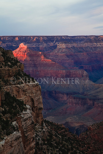 Setting sun lights up the walls and points in Grand Canyon