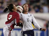06 November,  2004.   USWNT forward Abby Wambach (16) and Katrine Pedersen (3) fight for the ballat  Lincoln Financial Field in Philadelphia, Pa.