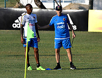 BARRANQUILLA - COLOMBIA - 20 – 03 - 2017: Jose Peckerman (Der.), tecnico de la Selección Colombia, da instrucciones a Luis Quiñones, jugador, durante entreno en las canchas del Polideportivo Universidad Autonoma del Caribe. El equipo colombiano se prepara en Barranquilla para el partido contra el seleccionado de Bolivia el 23 de marzo, partido clasificatorio a la Copa Mundial de la FIFA Rusia 2018. / Jose Peckerman (R), coach of Colombia´s Team, gives instructions to Luis Quiñones, player, during a training in the grounds of the Sports Center of Autonoma del Caribe University. Colombia team prepares in Barranquilla for the match against the national team of Bolivia on March 23, qualifying for the FIFA World Cup Russia 2018. Photo: VizzorImage / Luis Ramirez/ Staff.