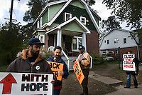Activists from the New Marcus Garvey Movement/New Black Panthers Movement demonstrate in front of a house being used as a drug den in Detroit, Michigan.