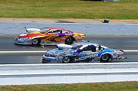 May 15, 2011; Commerce, GA, USA: NHRA pro stock driver Greg Stanfield (far lane) along side Allen Johnson during the Southern Nationals at Atlanta Dragway. Mandatory Credit: Mark J. Rebilas-