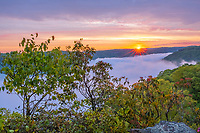 New River Gorge National Park, West Virginia. Sunrise over New River Gorge from Kaymoor View Point. Morning Fog in the Gorge.