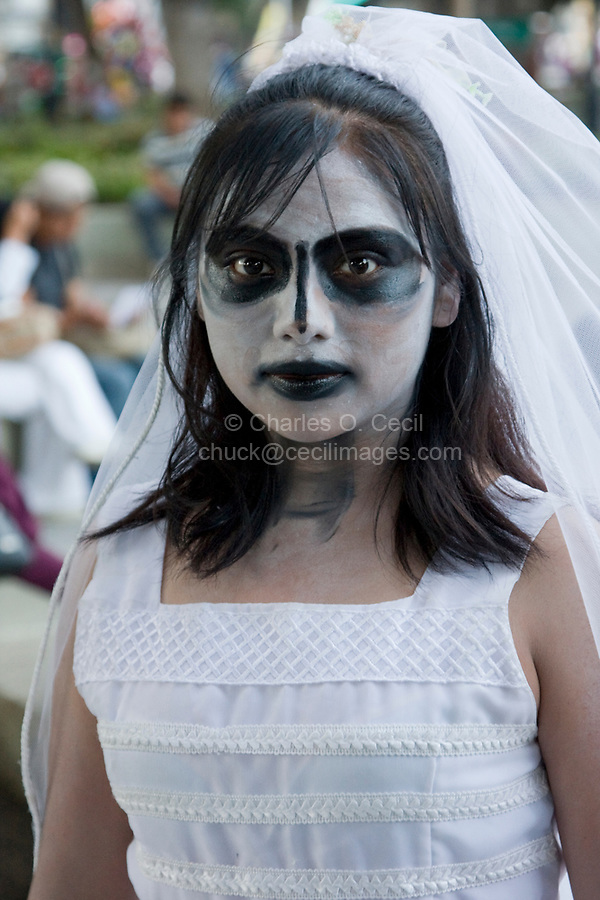 """Oaxaca, Mexico, North America.  Day of the Dead Celebrations.  This girl is in the costume of an """"Angelito"""", a Little Angel, symbolizing children who die before having their First Communion.  She is participating in a """"comparsa"""", a procession of children in costume, to celebrate the Day of the Dead, when Oaxacans honor their dead ancestors."""