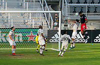 WASHINGTON, DC - NOVEMBER 8: Donovan Pines #23 of D.C. United heads a ball in the goal during a game between Montreal Impact and D.C. United at Audi Field on November 8, 2020 in Washington, DC.