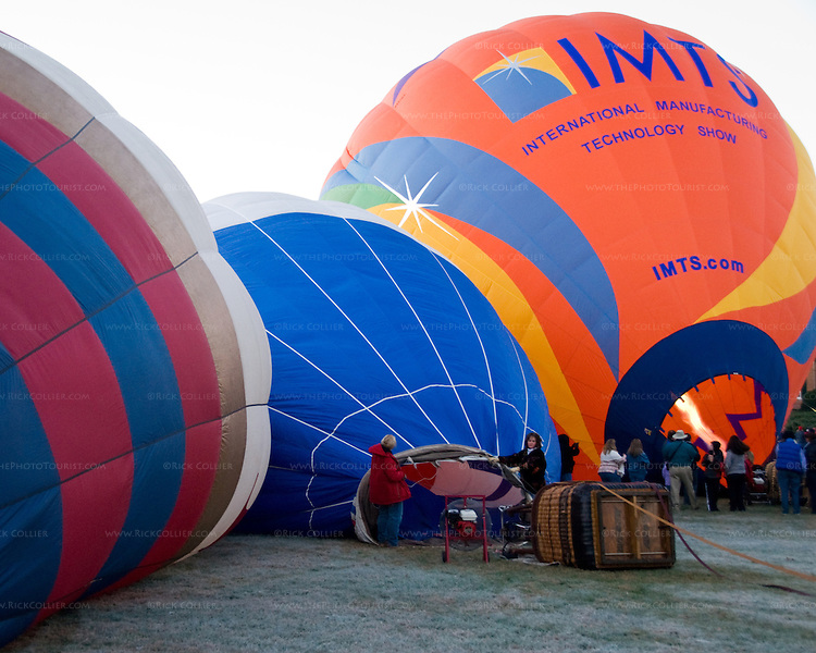 Crews labor to inflate balloons first thing in the morning at the annual Winchester Balloon Festival.  Long Branch Farm, Winchester, Virginia, USA.  © RickCollier.com.