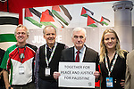 © Joel Goodman - 07973 332324 . 28/09/2016 . Liverpool , UK . JOHN MCDONNELL poses with Justice for Palestine supporters whilst touring the exhibition during the final day of the Labour Party Conference at the ACC in Liverpool . Photo credit : Joel Goodman