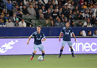 CARSON, CA - MARCH 07: Russell Teibert #31 of the Vancouver Whitecaps passes off the ball during a game between Vancouver Whitecaps and Los Angeles Galaxy at Dignity Health Sports Park on March 07, 2020 in Carson, California.