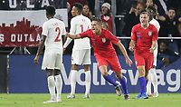 ORLANDO, FL - NOVEMBER 15: Aaron Long #3 of the United States scores a goal and celebrates during a game between Canada and USMNT at Exploria Stadium on November 15, 2019 in Orlando, Florida.