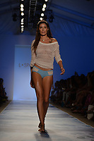 MIAMI BEACH, FL - JULY 19: A model walks the runway at the L*Space By Monica Wise fashion show during Mercedes-Benz Fashion Week Swim 2015 at The Raleigh at Raleigh Hotel on July 19, 2014 in Miami Beach, Florida<br />
