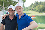 Horseriders Neil Callan (left) and Zac Purton pose for a photograph at UBS pavilion during Hong Kong Open golf tournament at the Fanling golf course on 23 October 2015 in Hong Kong, China. Photo by Moses Ng / Power Sport Images
