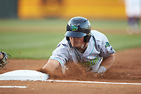 Mitch Longo (10) of the Lynchburg Hillcats dives back to first base during the game against the Winston-Salem Dash at BB&T Ballpark on May 3, 2018 in Winston-Salem, North Carolina. The Dash defeated the Hillcats 5-3. (Brian Westerholt/Four Seam Images)
