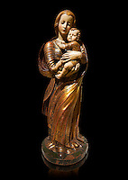 Gothic wooden statue of Madonna and Child by Seguidor de Diego de Siloe of Burgos, circa 1530-1540, tempera and gold leaf on wood, from the church of San Miguel de Medina del Campo, Valladolid..  National Museum of Catalan Art, Barcelona, Spain, inv no: MNAC  131050. Against a black background.