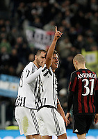 Calcio, Serie A: Juventus vs Milan. Torino, Juventus Stadium, 21 novembre 2015. <br /> Juventus' Paulo Dybala, center, is congratulated by his teammate Leonardo Bonucci after scoring the winning goal as AC Milan's Luca Antonelli, right, reacts during the Italian Serie A football match between Juventus and AC Milan at Turin's Juventus stadium, 21 November 2015. Juventus won 1-0.<br /> UPDATE IMAGES PRESS/Isabella Bonotto
