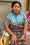 Portrait of Guatemalan woman eating a lollipop in Zunil, Guatemala in the Western Highlands