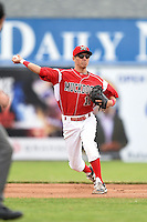 Batavia Muckdogs shortstop Aaron Blanton (11) throws to first during a game against the Mahoning Valley Scrappers on June 20, 2014 at Dwyer Stadium in Batavia, New York.  Batavia defeated Mahoning Valley 7-4.  (Mike Janes/Four Seam Images)