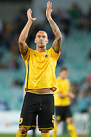 SYDNEY, AUSTRALIA - JULY 31, 2010: Leonardo Pereirar of AEK Athens thanks the crowd after the match between AEK Athens FC and Glasgow Rangers at the 2010 Sydney Festival of Football held at the Sydney Football Stadium on July 31, 2010 in Sydney, Australia. (Photo by Sydney Low / www.syd-low.com)
