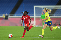 YOKOHAMA, JAPAN - AUGUST 6: Deanne Rose #6 of Canada and Amanda Ilestedt #13 of Sweden battle for the ball during a game between Canada and Sweden at International Stadium Yokohama on August 6, 2021 in Yokohama, Japan.