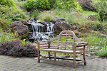 Plaza and bench by Waterfall, Oregon Gardens, Silverton, Oregon, USA, an 80 acre botanical garden in the Willamette Valley.  Windy day.  HDR image. This image available for license through exclusive agency.  Please contact the photographer
